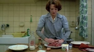 I think the was the point in the film when I started to go insane, watching her mold the meatloaf 10 billion times.