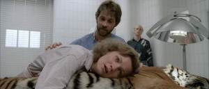 Random vet creepily puts his hand on McClane's back as she lays on a sedated tiger, while Dollarhyde stands in the corner and watches. Weird.